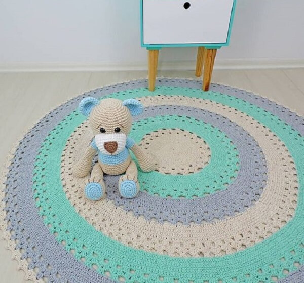Invest in a round crochet rug with light shades for baby's room