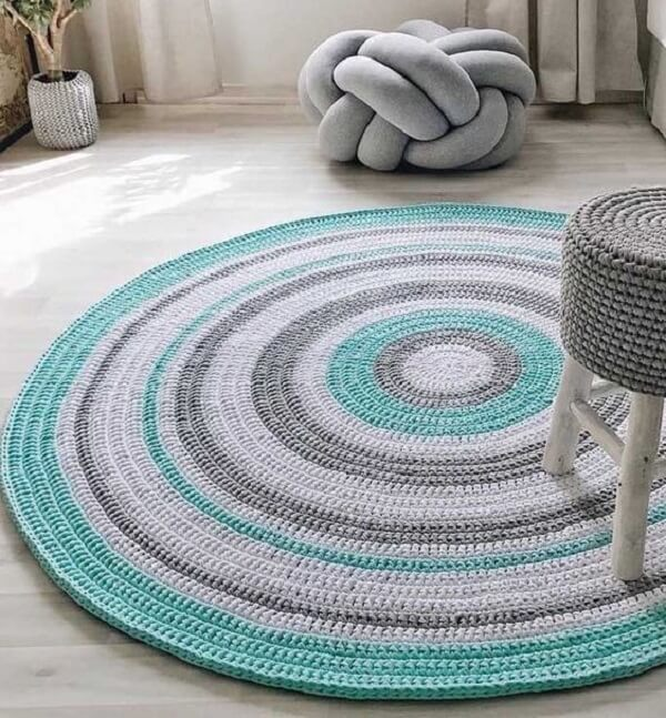 Clean living room with colorful round crochet rug