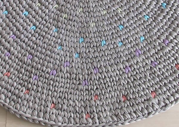 Gray crochet rug with colorful details