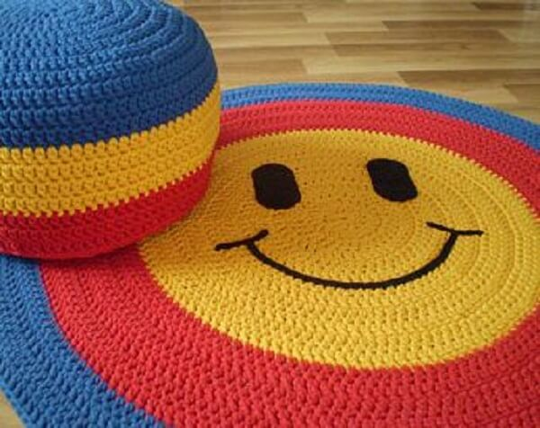 Colorful round crochet rug with Smile