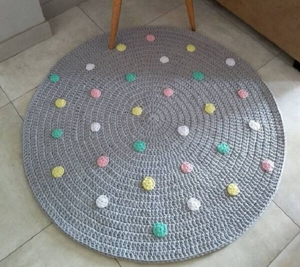 Round crochet rug with colorful details