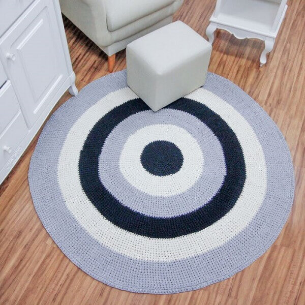Baby room with striped crochet rug