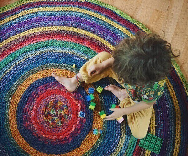 The crochet rug pleases even the little ones in the house