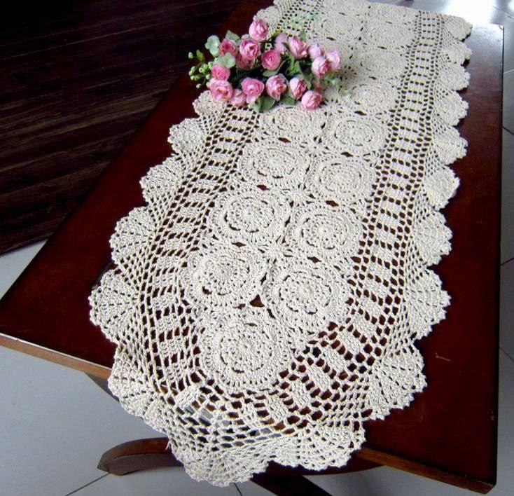 detailed white crochet table runner with flowers