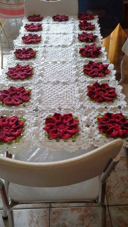 Crochet table runner with red flowers