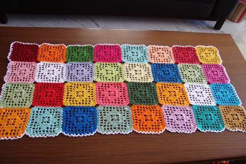 Colorful square crochet table runner