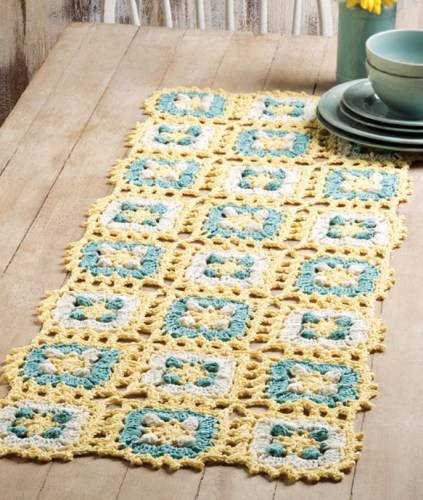 Blue and yellow crochet table runner
