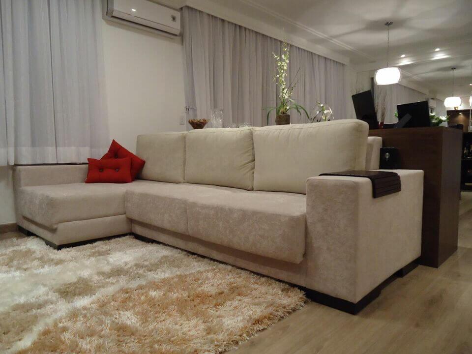medusa rug - TV room with plush rug and L-shaped sofa