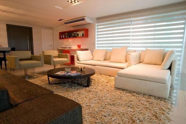 medusa rug - living room with white sofa and shag rug