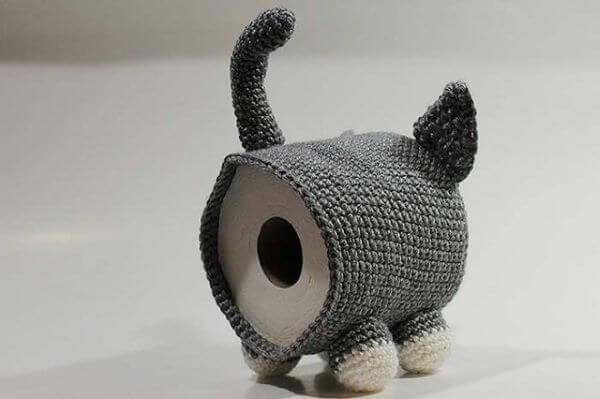 Crochet toilet paper holder in the shape of a cat