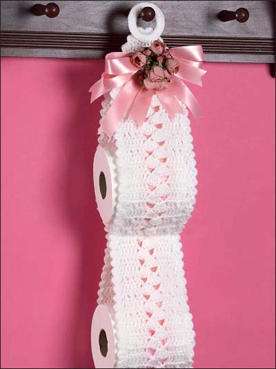Toilet paper holder with flowers and ribbon bow