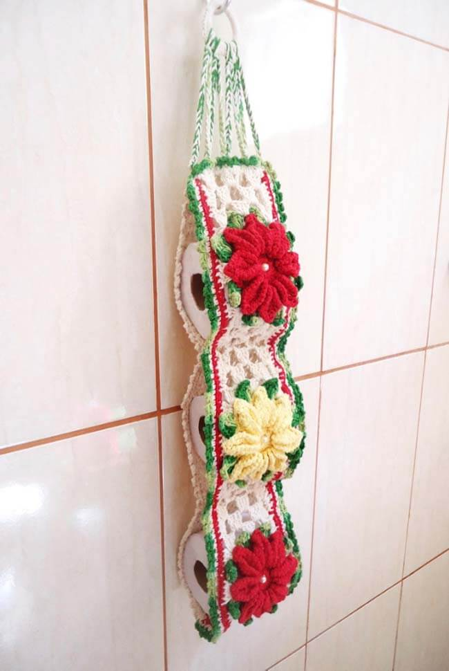Crochet toilet paper holder with red and yellow flowers