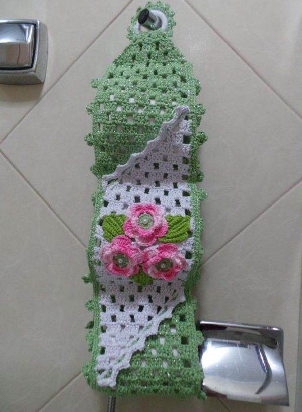 Green and pink crochet toilet paper holder