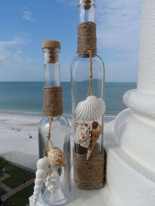 Bottle decorated with shells and string