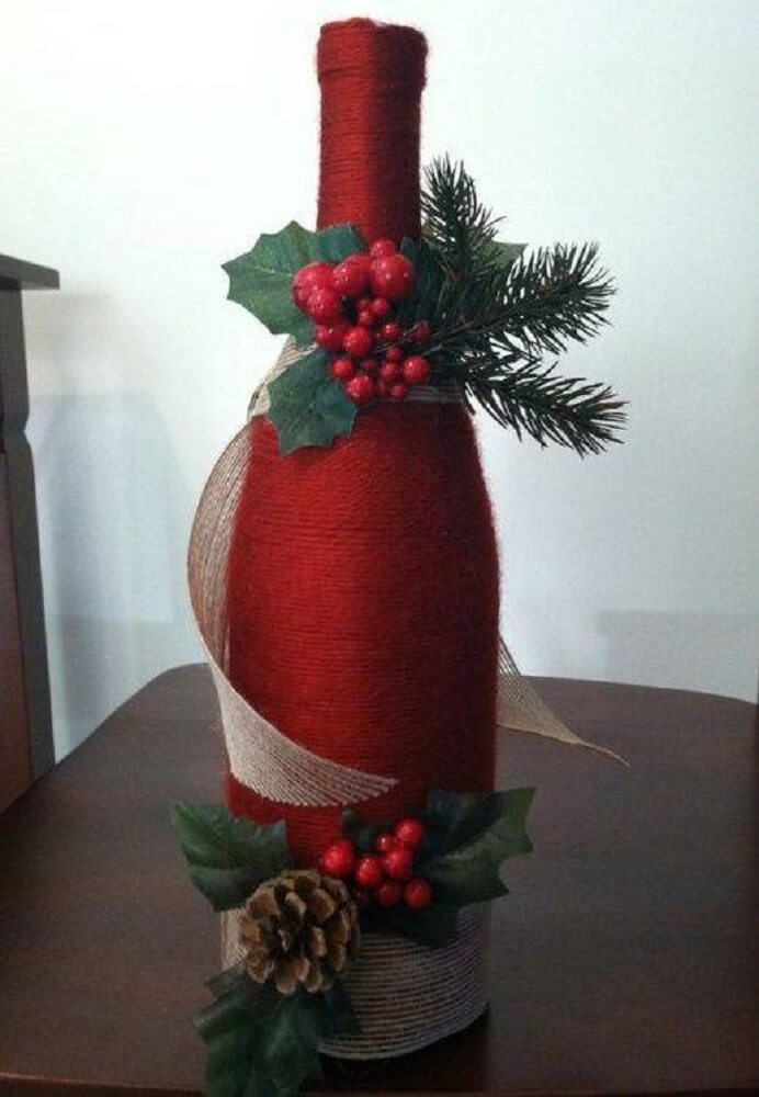 Bottle decorated in red for Christmas