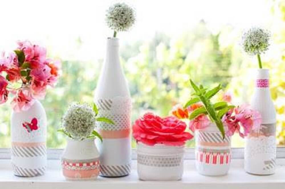 Decoration of white bottles with lace for flower pots
