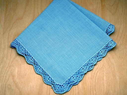 Blue dishcloth with crochet nozzle in the same color Photo by Bumblebee Linens