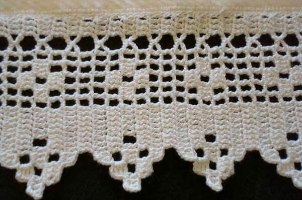 White crochet nozzle with different designs Foto de Tapetes Croche