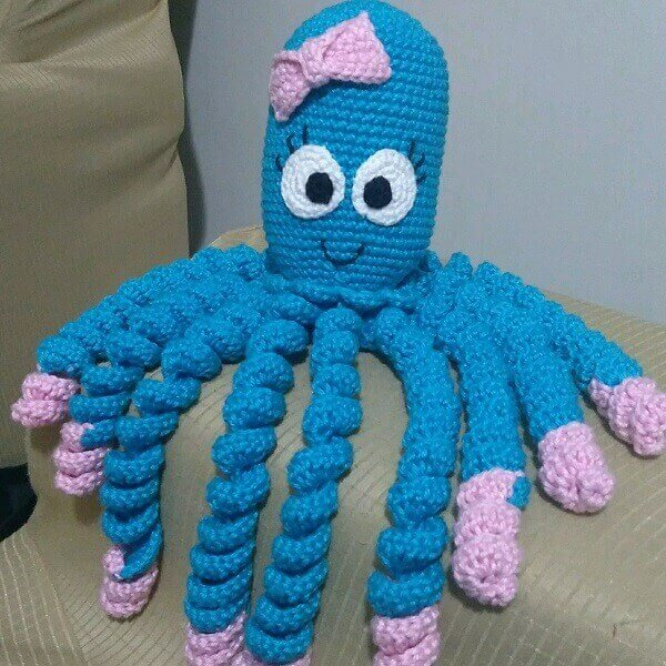Blue crochet octopus with bows and little shoes