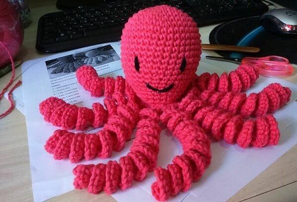 Crochet octopus in pink color