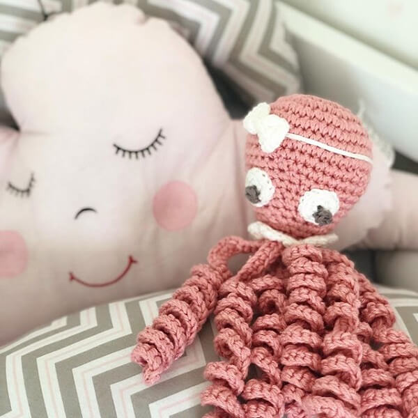 Delicate crochet octopus model in pink tone