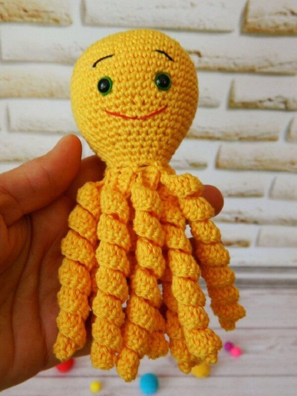 Cheerful crocheted octopus in yellow tone
