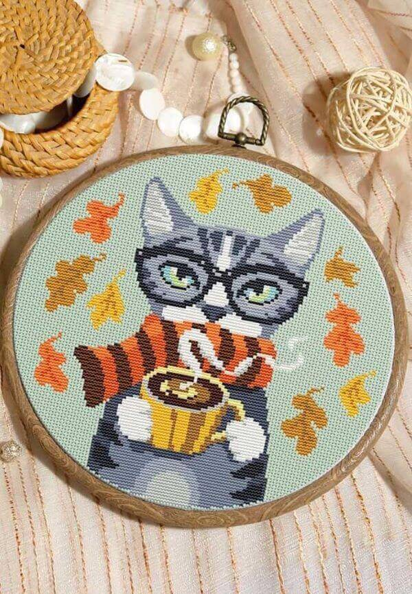 Kitty cross stitch with coffee, full of colors and details