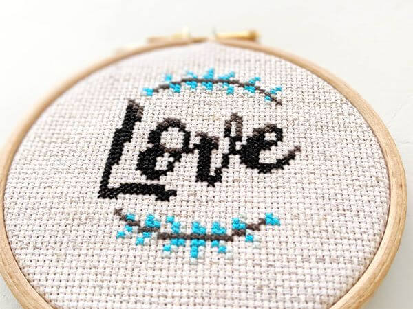 Letters in cross stitch to form the word LOVE
