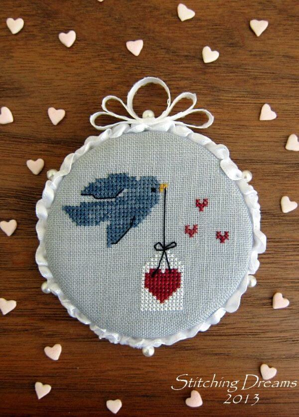 Cross stitch with birdie and heart
