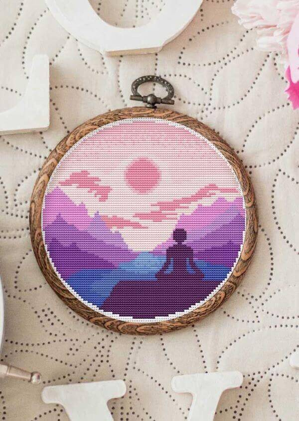 Frame with cross stitch in shades of purple