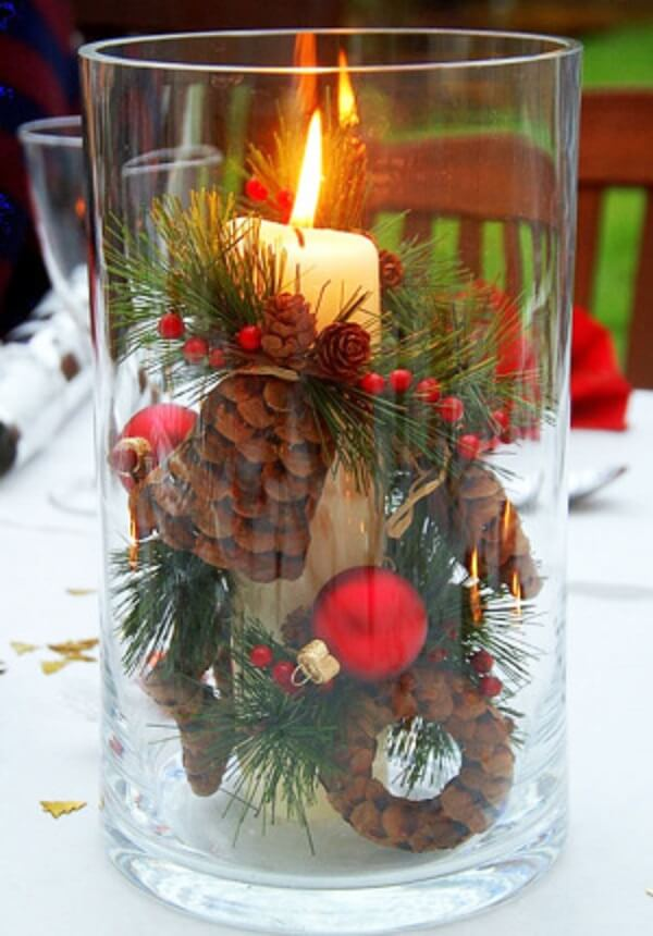 Separate a large clear glass and place several Christmas ornaments inside