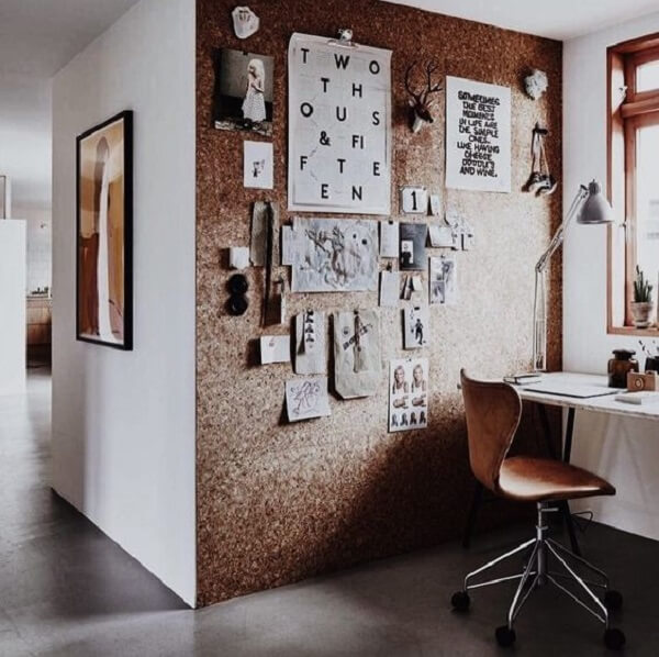 Home office with large corkboard assists in fixing photos and decorative elements