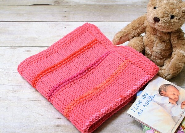 Baby pink blanket made in different types of Tunisian crochet stitches