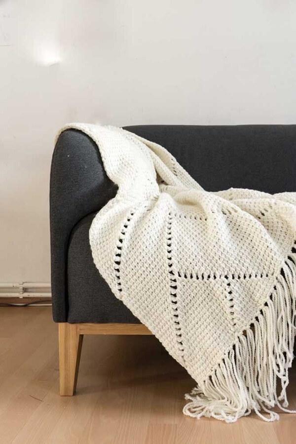 White sofa blanket made in Tunisian crochet