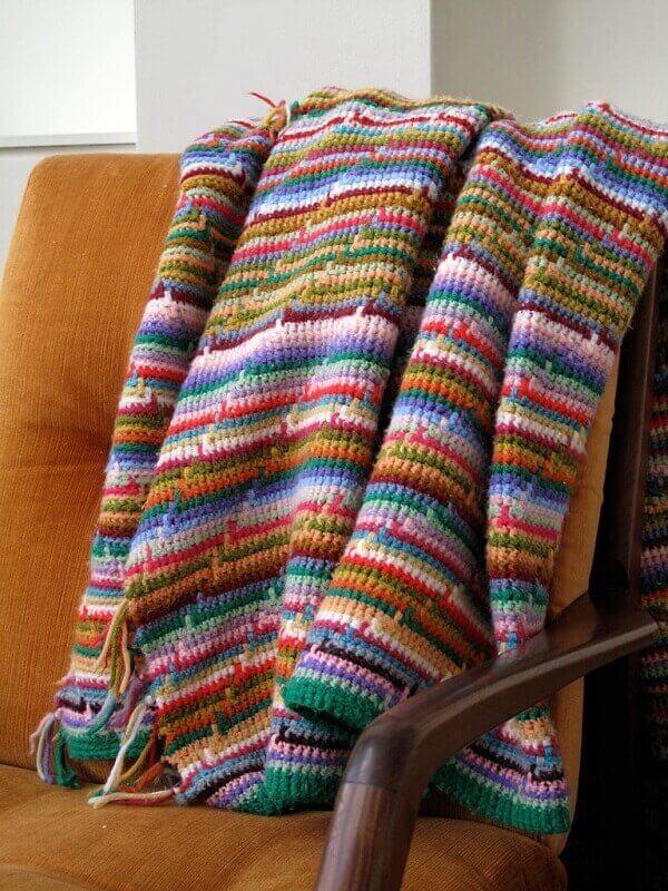 Colorful sofa blanket made in Tunisian crochet