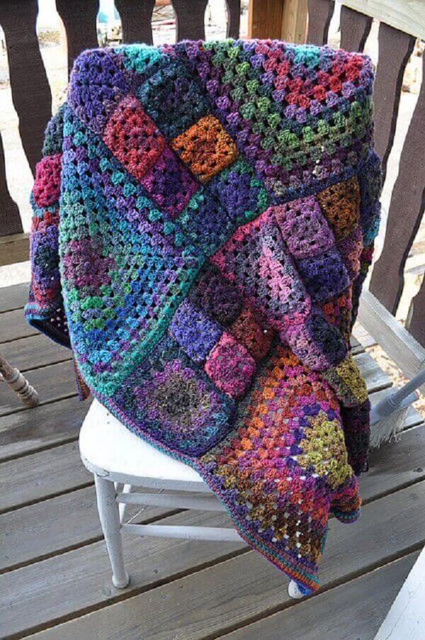 Colorful blanket model made in Tunisian crochet