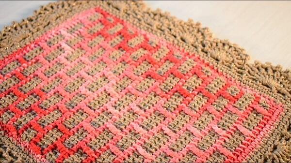 Delicate rug made in Tunisian crochet