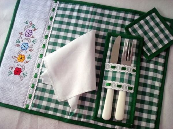 Placemats with striped flatware holder with embroidery on the side