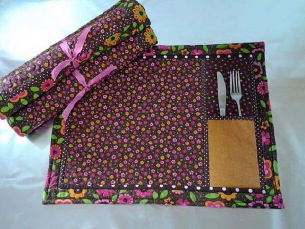 Fabric placemat with patterned silverware holder