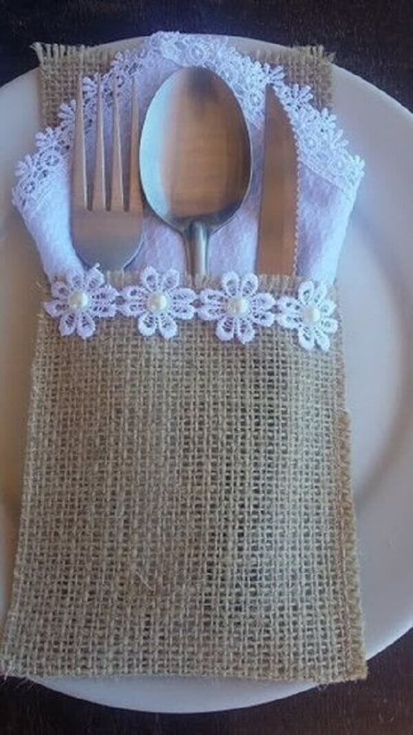 Application of flowers in the fabric cutlery holder