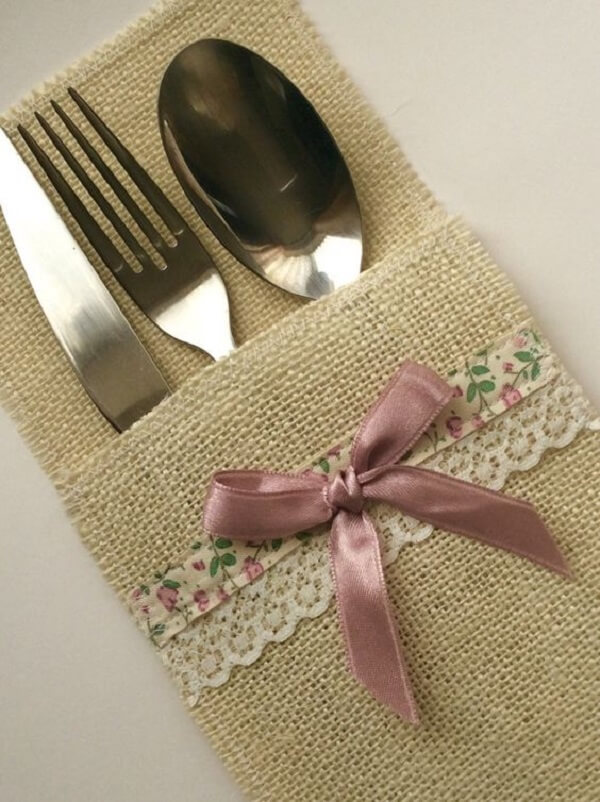 Delicate cutlery holder with lace and pink ribbon