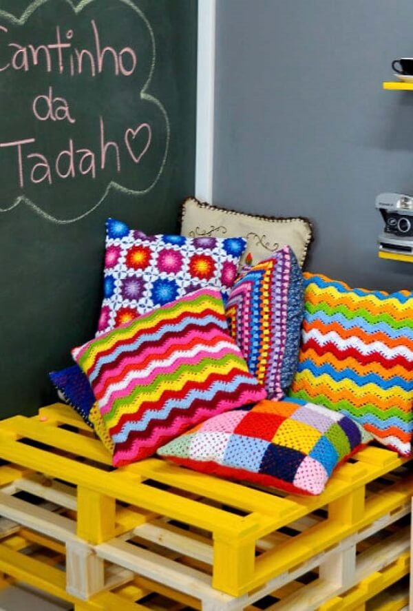 Pallet bench with colorful cushions