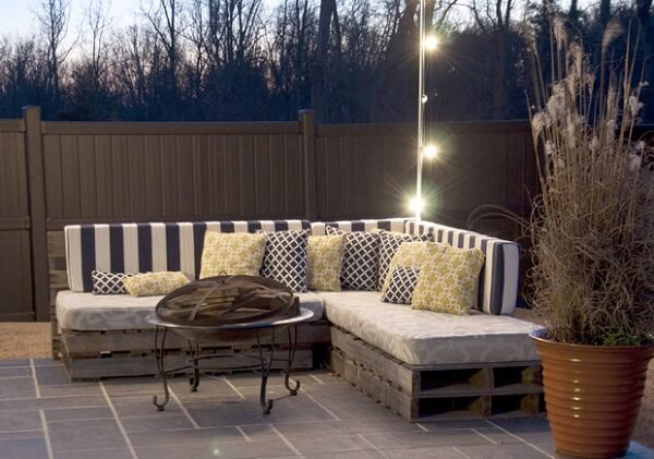 Cozy balcony with bench made of pallet and blinkers