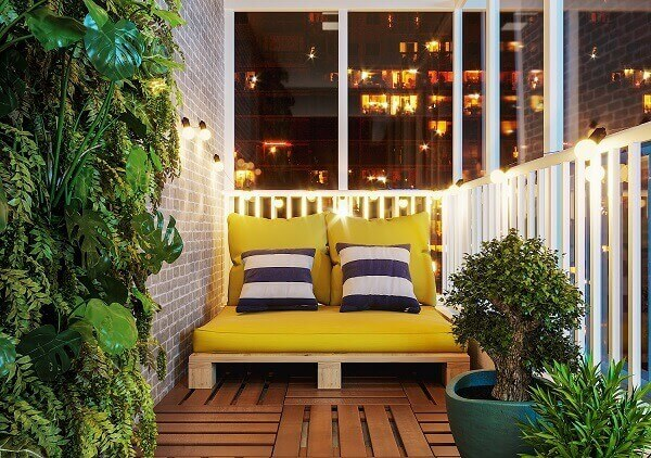Small balcony with pallet bench.