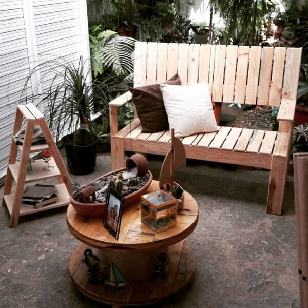 Rustic balcony with reel table and pallet bench