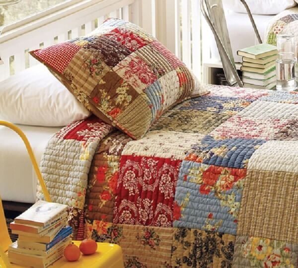 Patchwork quilt in bed and technique used on the pillow