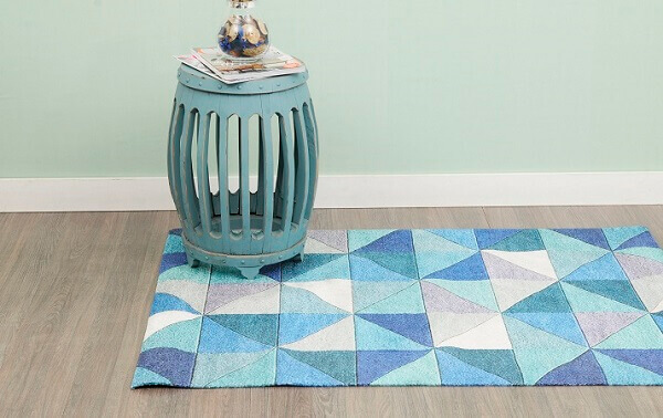 Patchwork rug in shades of blue, white and gray