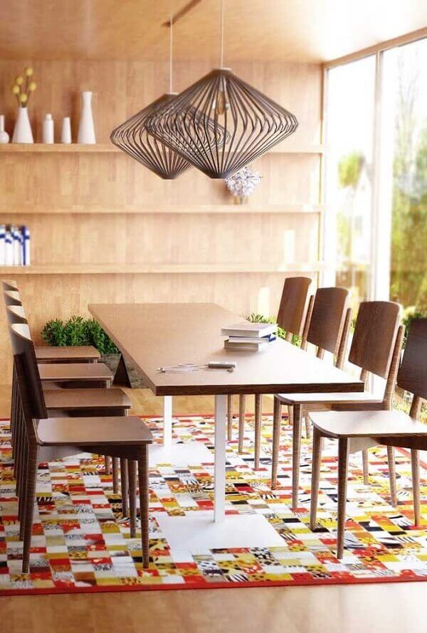 The colorful patchwork rug beautifully decorates the dining room