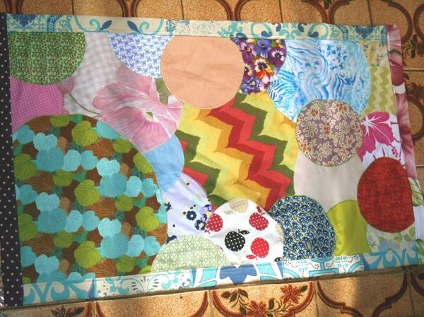 Merge shapes and colors on your patchwork rug