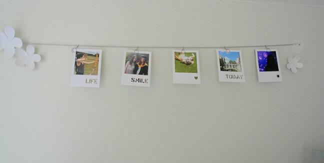 Varal de fotos com palavras positivas